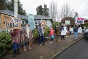 Emotions run high at small rally to open schools