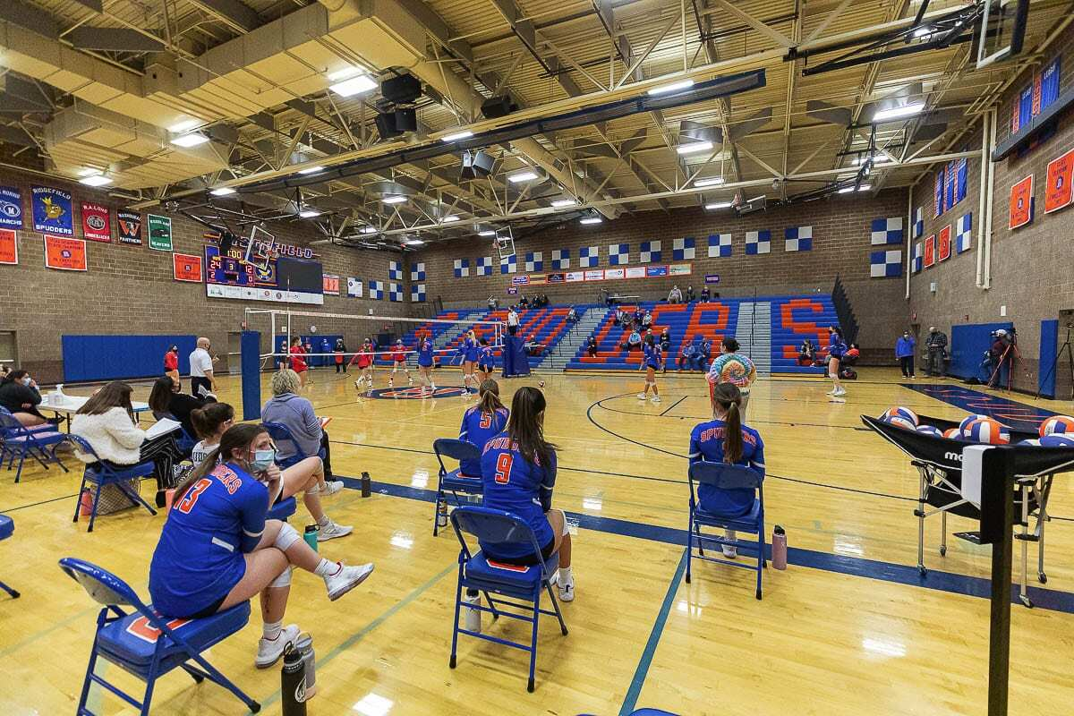Seats in the team area were spread out, and the few fans allowed to watch the match had to distance themselves as well in the return of high school volleyball in the region. Ridgefield would go on to defeat Mark Morris. Photo by Mike Schultz