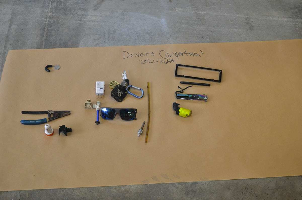 Photo #4 shows the items that were in the driver's area of the vehicle. Photo courtesy of SW Washington Independent Investigative Response Team