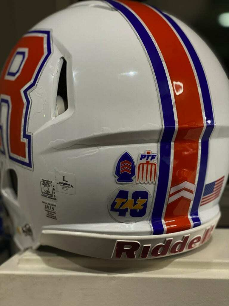 "A closer look at the Ridgefield helmet with the ""Taz 40"" decal. Other teams will be wearing the decal as well, a tribute to a man who loved football and the values the game teaches. Photo courtesy Scott Rice"