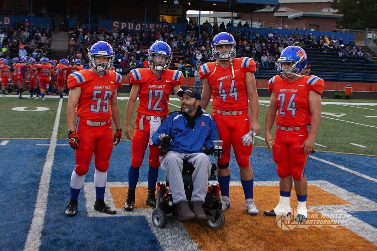 Taz Roberts, shown here when he was an honorary team captain for the Ridgefield Spudders, died in November. Ridgefield, and many teams throughout Southwest Washington, will pay tribute to Taz, who loved football and supported athletes everywhere, with a decal on their helmets. Photo courtesy of the Roberts family
