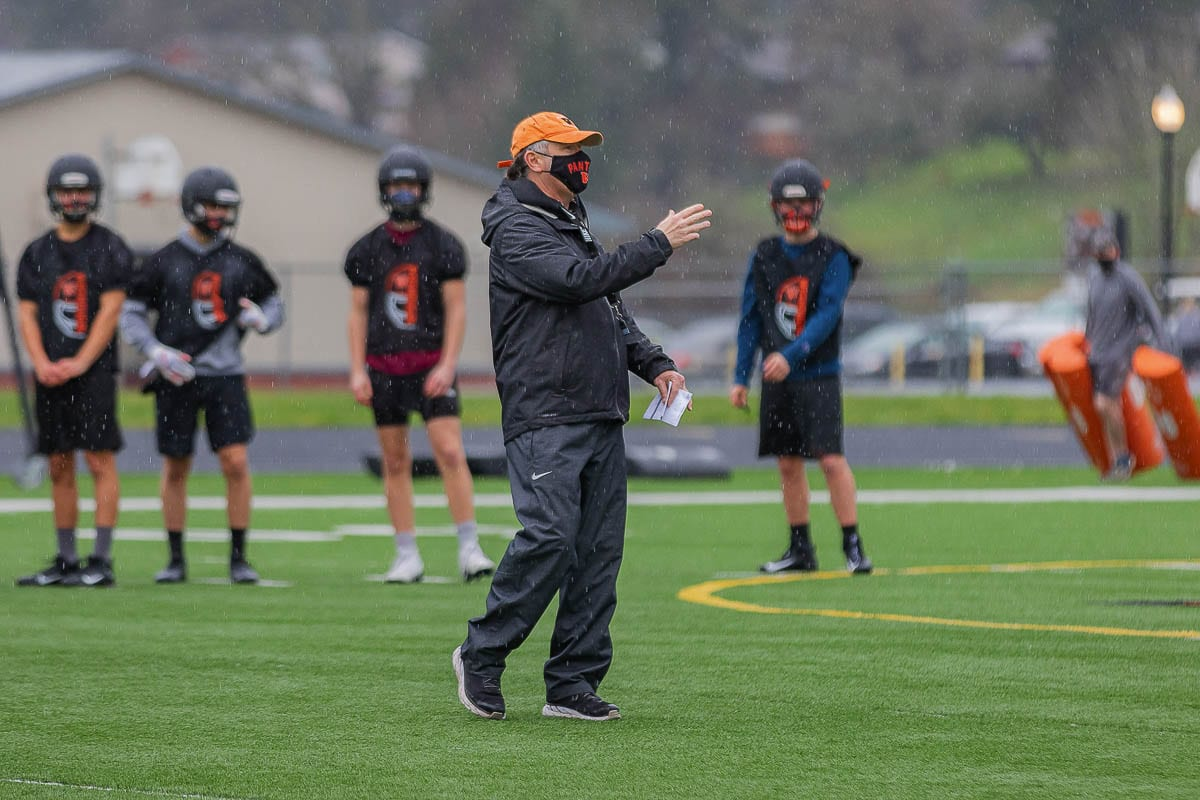 """It was colder than August, and there was a lot of rain, too, but Washougal football coach David Hajek said he and the Panthers were just thrilled to be on the field for the first day of official practice for the """"fall"""" sports season. Photo by Mike Schultz"""