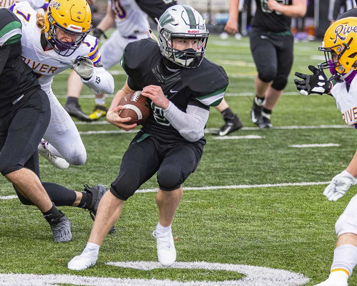 Woodland quarterback JJ Fuerst scored his team's first touchdown of the season. Photo by Mike Schultz