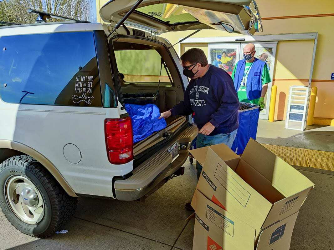 Matt Hunt of Vancouver drops off donations at the Fisher's Landing Goodwill store on Wednesday. Photo by Chris Brown