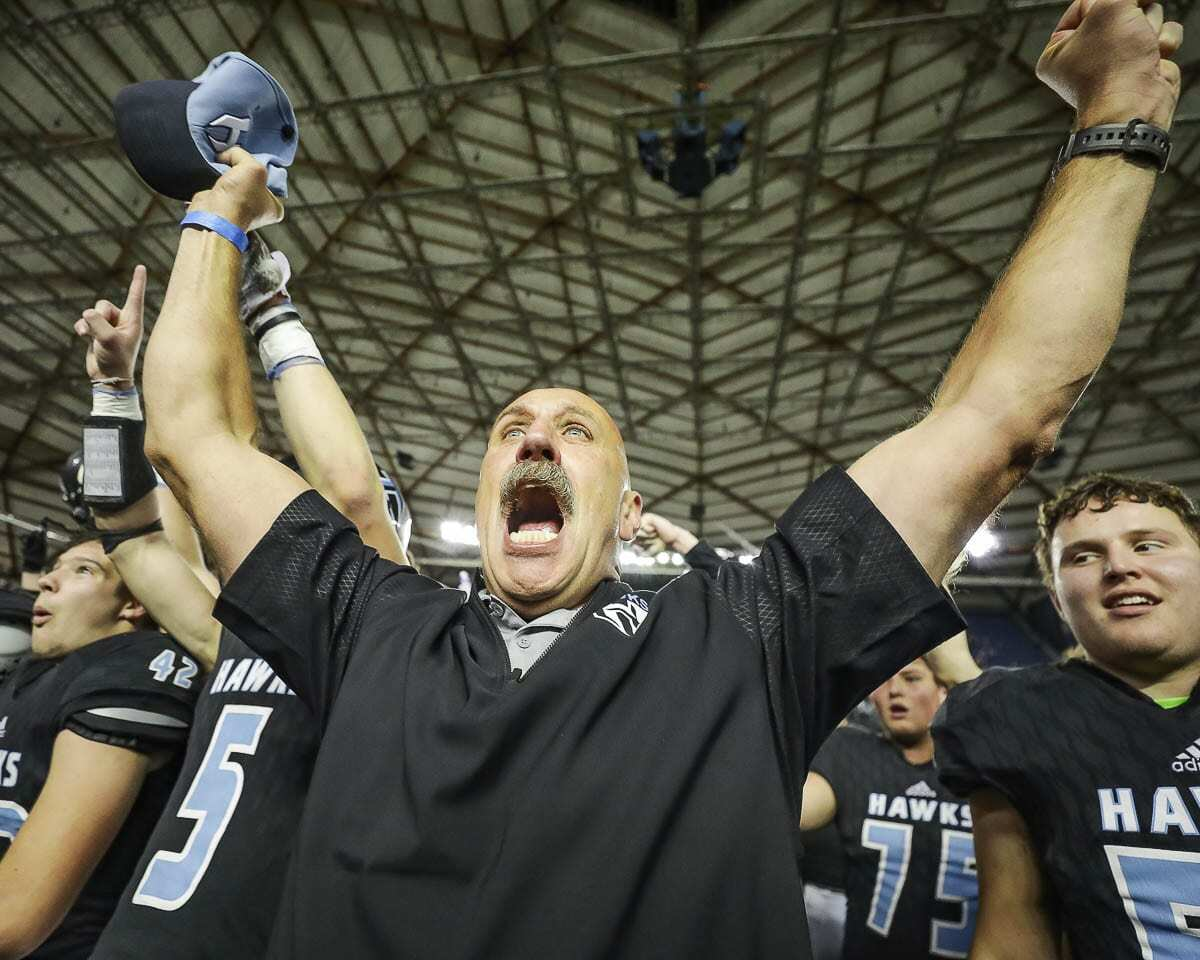 Hockinson coach Rick Steele celebrates after one of the Hawks' two state championship victories. Photo by Mike Schultz