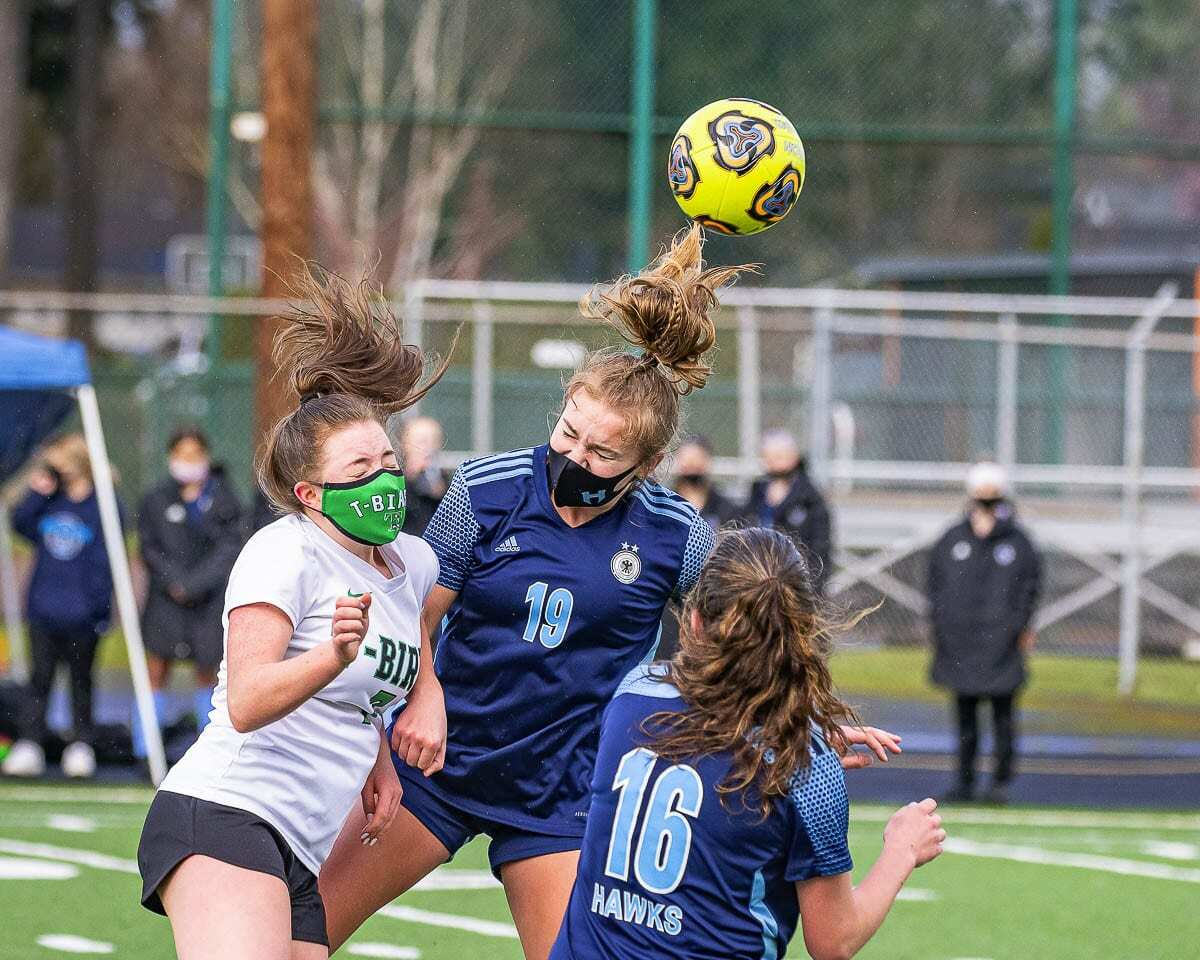 Payton Lawson (19) of Hockinson gets some air during her team's soccer match against Tumwater on Saturday. Lawson scored two goals in a 2-0 win to claim the district championship. Photo by Mike Schultz