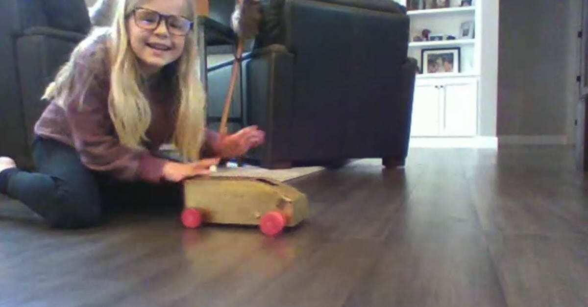Olivia Willis is happy to get her go-kart moving with the force of twisted rubber bands. Photo courtesy of Ridgefield School District