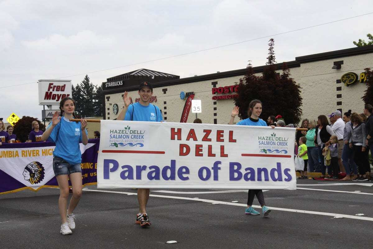 The lead banner team is seen here during the 2018 parade. The route is mostly the same each year, but always runs through the heart of where Hazel Dell and Salmon Creek meet. File photo