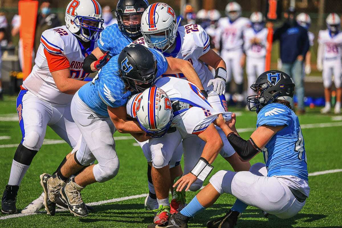 The Hockinson defense was all over Ridgefield. Even when Ridgefield moved the ball, the Hawks stopped the Spudders from getting in the end zone for most of the day in a 14-7 Hockinson victory. Photo by Mike Schultz
