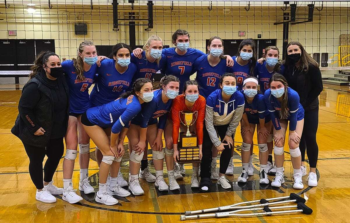 The Ridgefield Spudders completed an undefeated season by topping Woodland in the Class 2A District 4 volleyball championship Saturday at Hudson's Bay High School. Photo by Paul Valencia