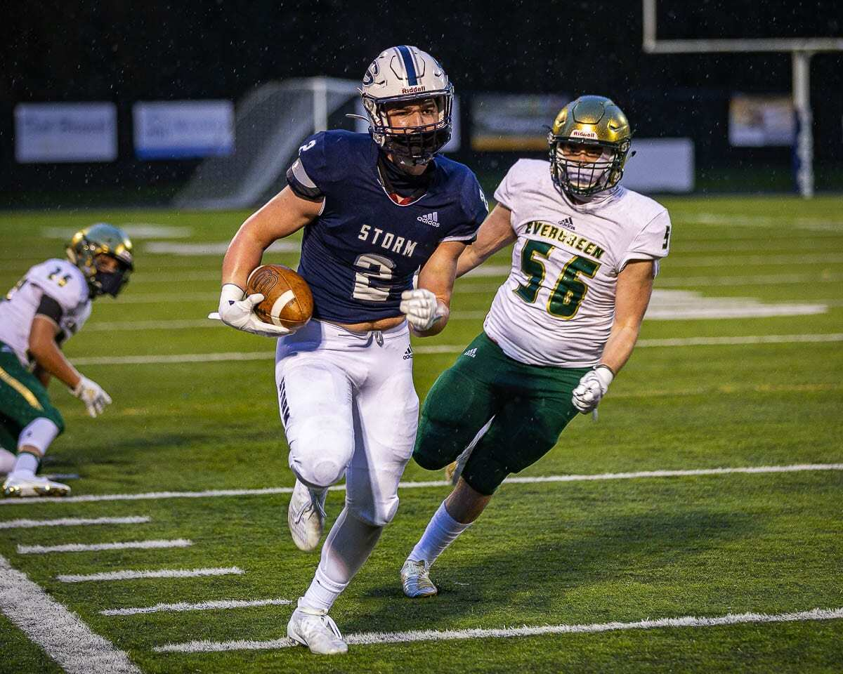 Rhett Sarvela races down the sideline in this photo. Later, he would grab a one-handed touchdown pass for the Skyview Storm. Photo by Mike Schultz