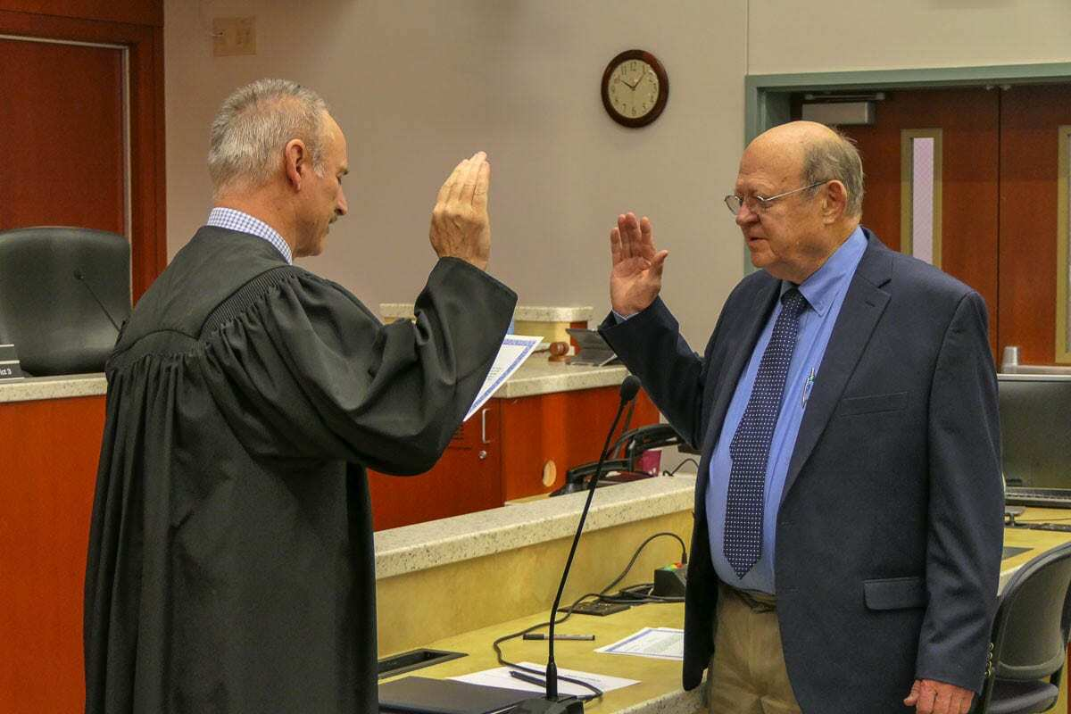 Judge Darvin Zimmerman (on left) is shown here in during a swearing-in ceremony held in December 2018. Photo by Chris Brown