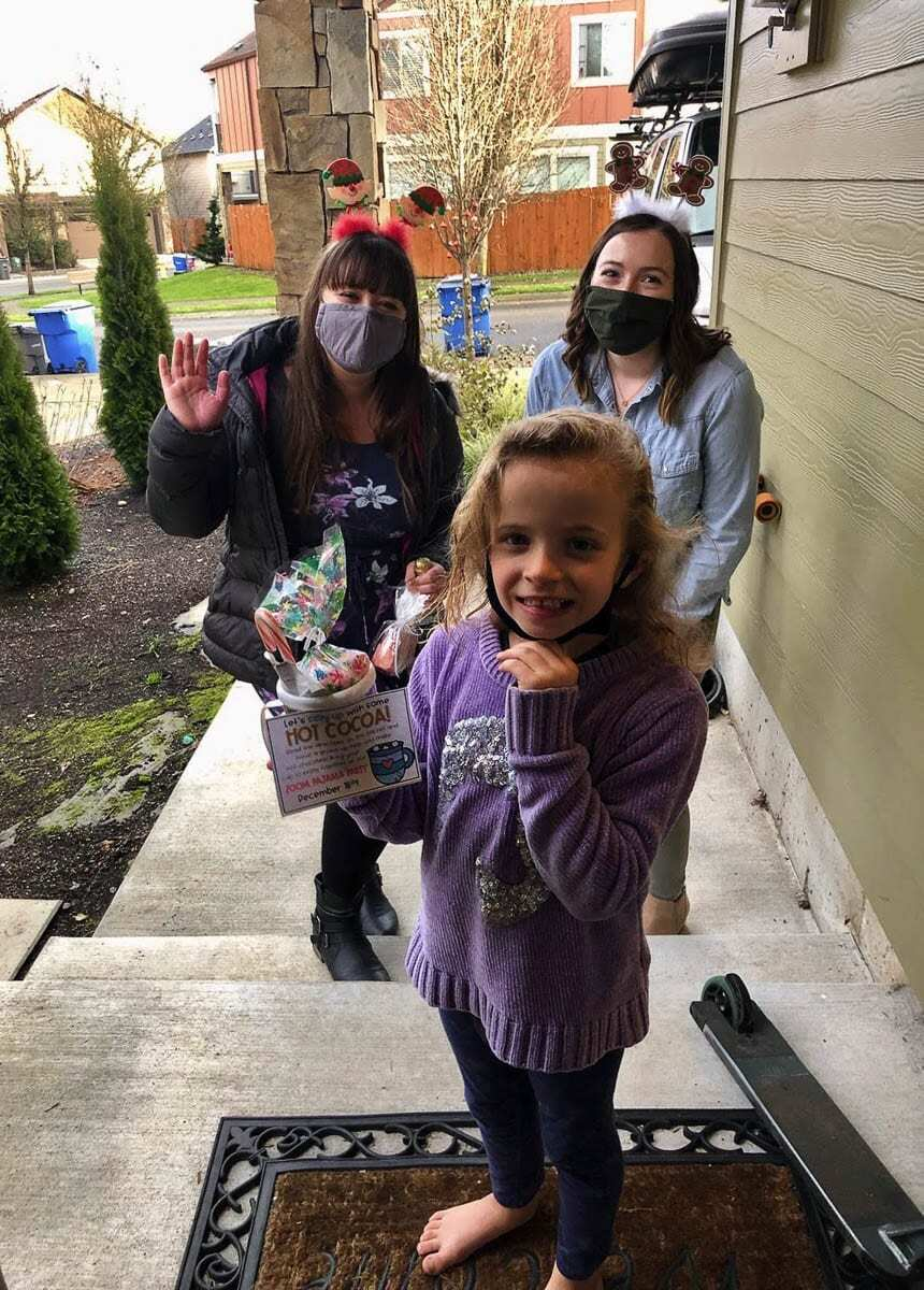 Teacher Shandel Oderman (on the right) and student teacher Briana Lewellen drop off a weekly learning packet for Timber Engstrom -- including a special treat and an invitation to the class Zoom Pajama Party. Photo courtesy of Ridgefield School District