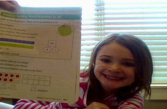 Teagan Devlin is proud to show off her math homework to the Zoom camera. Photo courtesy of Ridgefield School District
