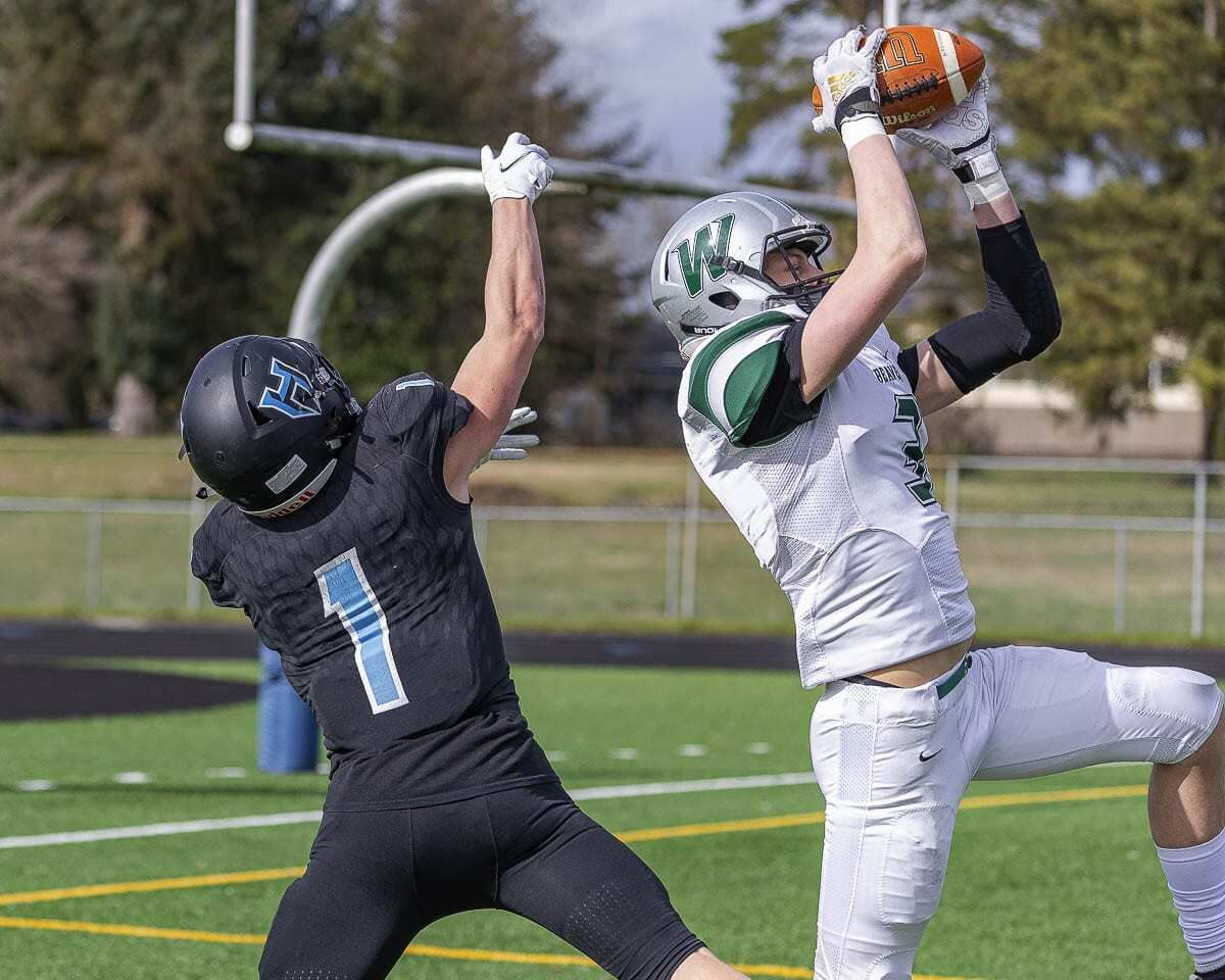 Justin Philpot intercepts a Hockinson pass in the end zone Saturday. The Woodland defense held Hockinson to just one touchdown on offense. Photo by Mike Schultz