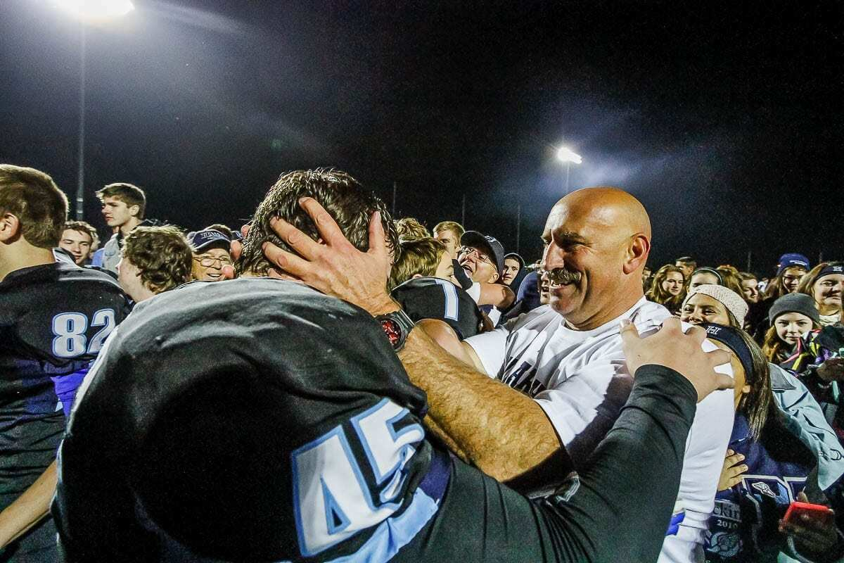Hockinson High School coach Rick Steele is shown here enjoying a special moment with one of his former players after another Hawks' victory. Photo by Mike Schultz