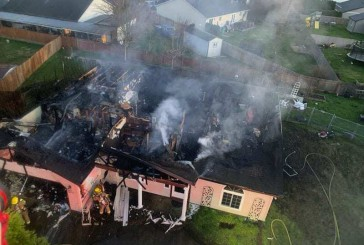 House fire displaces three people in Battle Ground