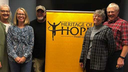 The HOH board from left to right: Bev Alley, Lisa Clear, Scott Stuart, Melody and Dan Miller, and Dave Williams (not pictured). Photo courtesy of Heritage of Hope