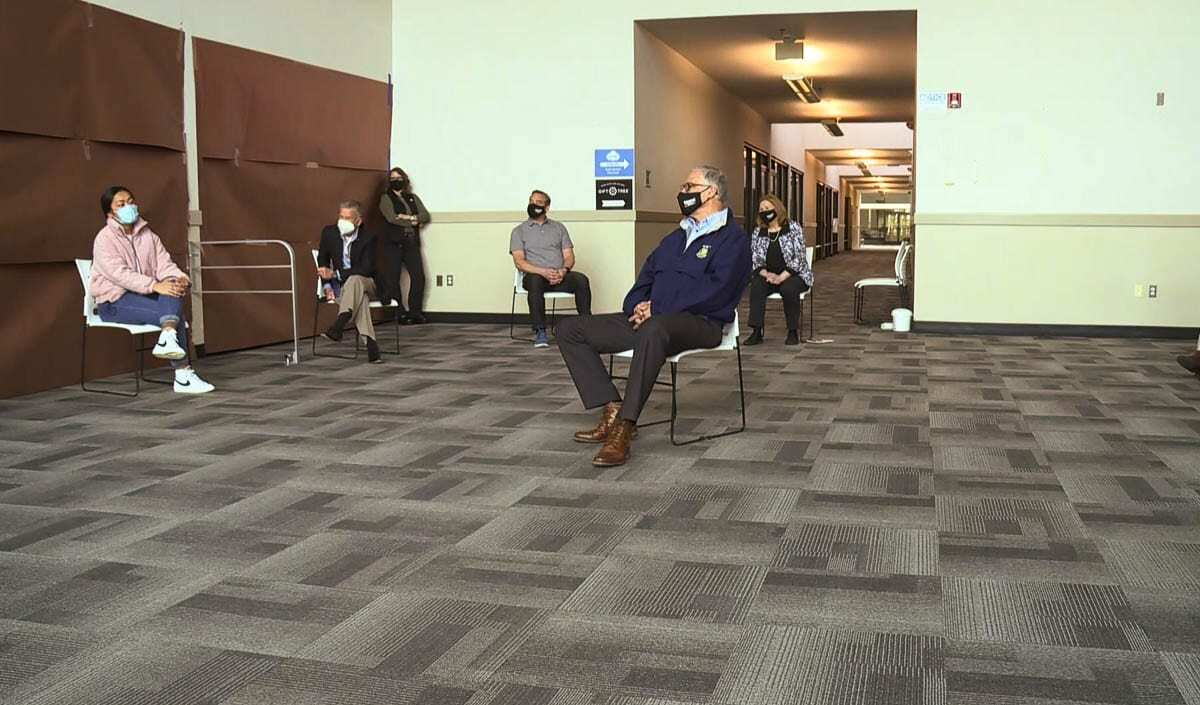 Washington Gov. Jay Inslee meets with elected officials and BIPOC community leaders during a visit to the Tower Mall vaccination and COVID testing site on Friday. Photo via KOIN-TV Live Stream
