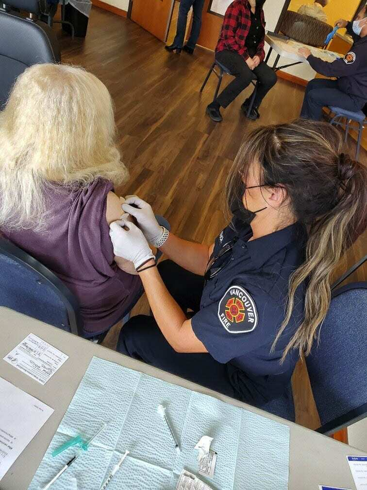 Vancouver Fire is providing two emergency trained personnel to stand by at the Tower Mall drive through vaccination clinic. Their sole responsibility is to treat anyone who may have an unexpected reaction to the vaccination. Photo courtesy of Vancouver Fire Department