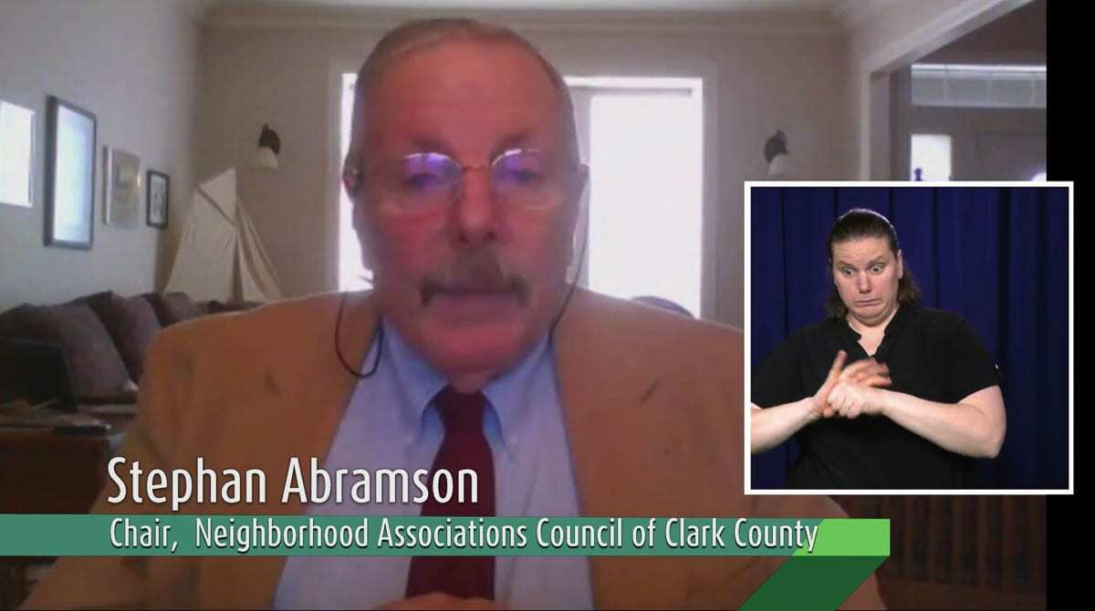 Stephen Abramson, the chair of the Neighborhood Associations Council of Clark County can be seen here naming Dr. Alan Melnick the Employee of the Year. Photo courtesy of CVTV