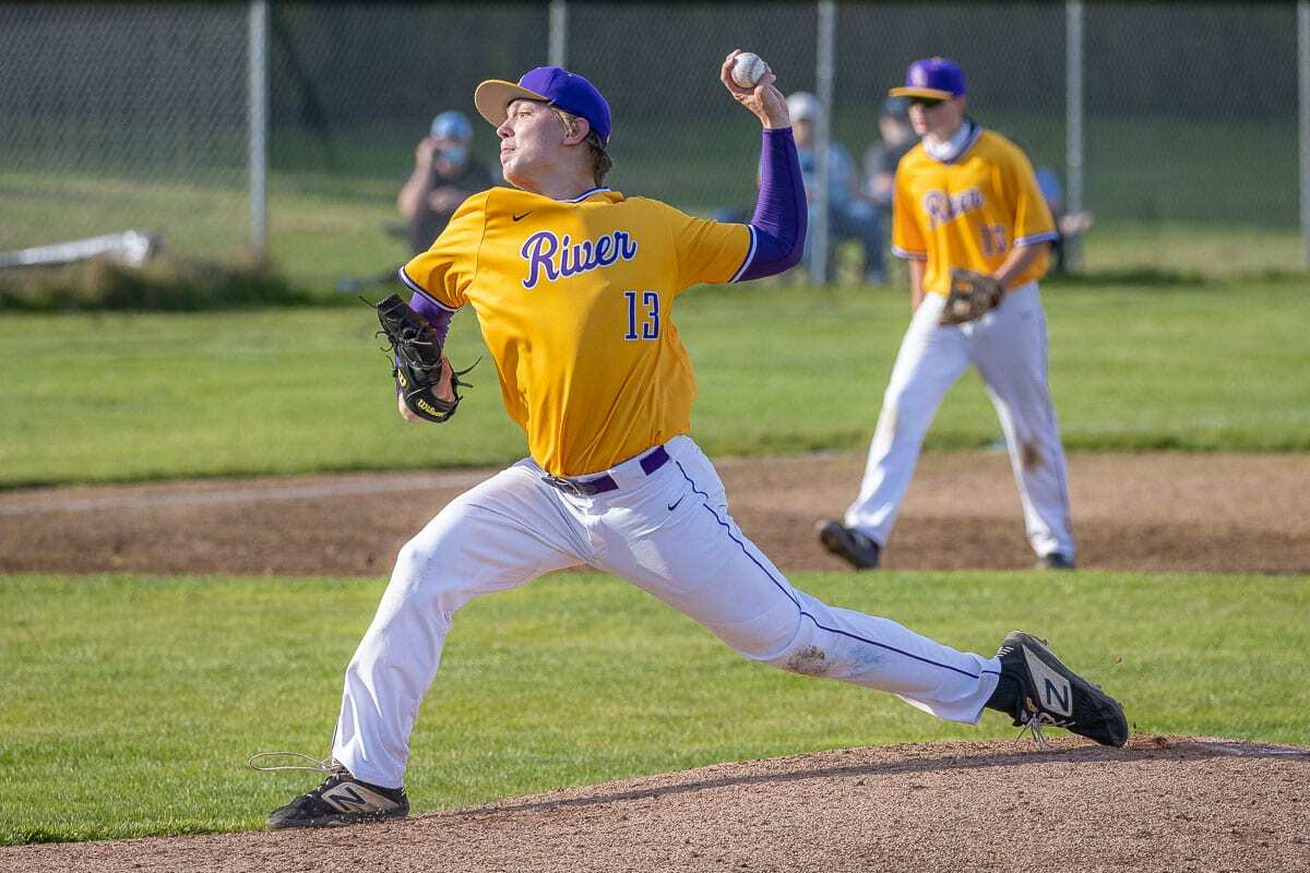 Sam Boyle of Columbia River delivers a pitch Wednesday. The Class 2A and 1A schools have already started spring sports, while the 4A and 3A schools are still finishing fall sports. All part of pandemic scheduling. Photo by Mike Schultz