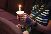 Community members gather for vigil to honor fallen police officer